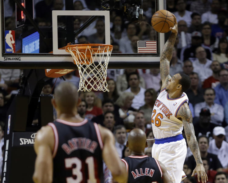 New York Knicks' Shannon Brown (26) prepares to dunk against the Miami Heat during the first half of an NBA basketball game in Miami, Thursday, Feb. 27, 2014. (AP Photo/Alan Diaz)