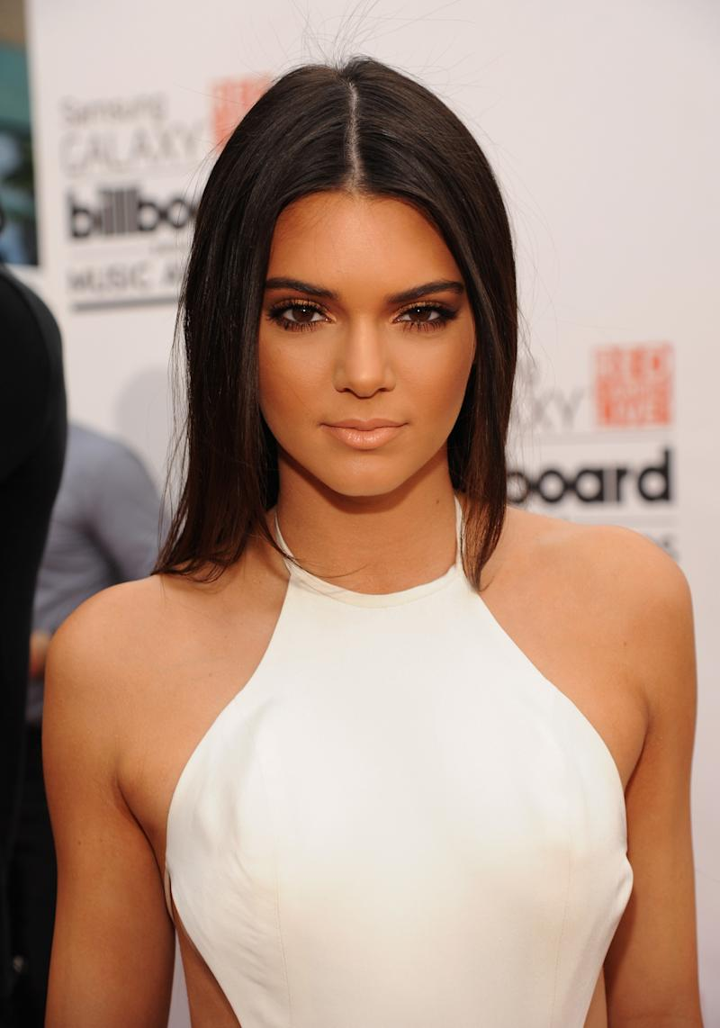 Glowing at the 2014 Billboard Music Awards, Jenner channels a bronzed goddess with sleek straight hair, sun-kissed skin and a golden smokey eye.