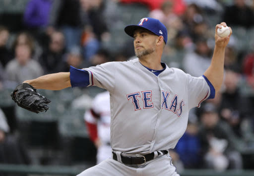 Texas Rangers starting pitcher Mike Minor throws against the Chicago White Sox during the first inning of a baseball game Sunday, May 20, 2018, in Chicago. (AP Photo/Nam Y. Huh)