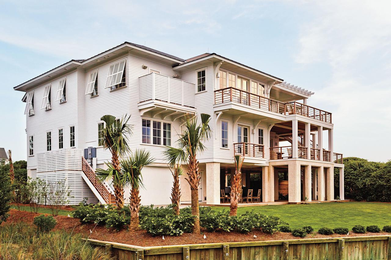 """<p><a href=""""http://www.barriebenson.com/"""" target=""""_blank"""">Barrie Benson</a> likes the newness knocked off of things. So when her client came to her wanting the interiors of a new-build beach home on North Carolina's Figure Eight Island to have a collected vibe that emphasized vintage, one would think the Charlotte-based designer would be thrilled. But despite her love of older, classic pieces, she was hesitant to go all vintage everywhere. """"If every piece is beaten-down and old, it's too much of one thing,"""" she says.</p> <p>But vintage certainly would have its place in the home's design. The five-mile, 1,300-acre barrier island near <a href=""""https://www.coastalliving.com/travel/atlantic/wilmington-north-carolina-weekend-getaway"""" target=""""_blank"""">Wilmington</a> has long been a vacation destination, and Barrie and her <a href=""""https://www.mgpb.com/"""" target=""""_blank"""">architect husband, Matt</a>, drew inspiration from the region's 1920s and """"30s beach cottages with wide, open porches and traditional details. It was a balancing act for Barrie, who layered contemporary patterns and fabrics in a beach-inspired, desaturated color palette with classic rattan furniture and woven, natural rugs (both a nod to early 20th-century Carolina beach cottage style). Matt, in turn, tempered modern architectural lines with details that acknowledge history: pecky cypress detailing and traditional tabby—a lime, water, sand, oyster shells, and ash material. Here, the Bensons share their tips for pulling off the balance between now and then.</p>"""