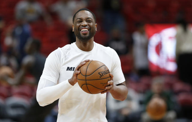 Miami Heat guard Dwyane Wade smiles as he warms up for the team's game against the Milwaukee Bucks (AP Photo)