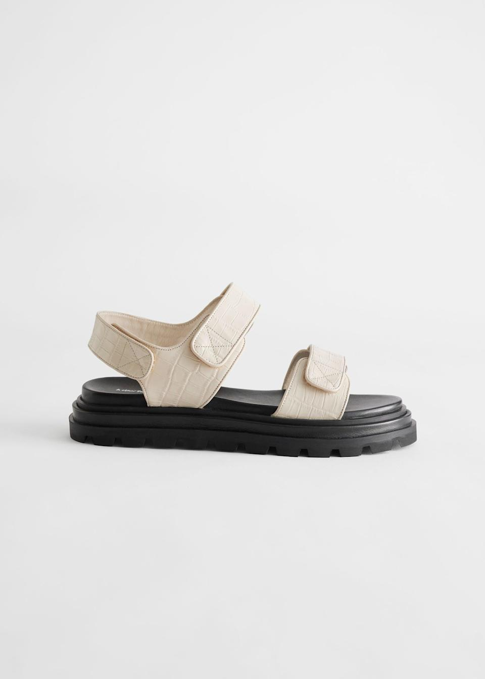 """<br><br><strong>& Other Stories</strong> Croc Embossed Leather Sandals, $, available at <a href=""""https://www.stories.com/en_gbp/shoes/flats/product.croc-embossed-leather-sandals-beige.0963309001.html"""" rel=""""nofollow noopener"""" target=""""_blank"""" data-ylk=""""slk:& Other Stories"""" class=""""link rapid-noclick-resp"""">& Other Stories</a>"""