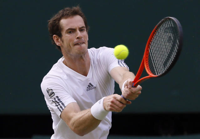 ADVANCE FOR WEEKEND EDITIONS, JUNE 21-22 - FILE - In this July 5, 2013, file photo, Andy Murray, of Britain, plays a shot to Jerzy Janowicz, of Poland, during their men's singles semifinal match at the All England Lawn Tennis Championships in Wimbledon, London. (AP Photo/Kirsty Wigglesworth, File)