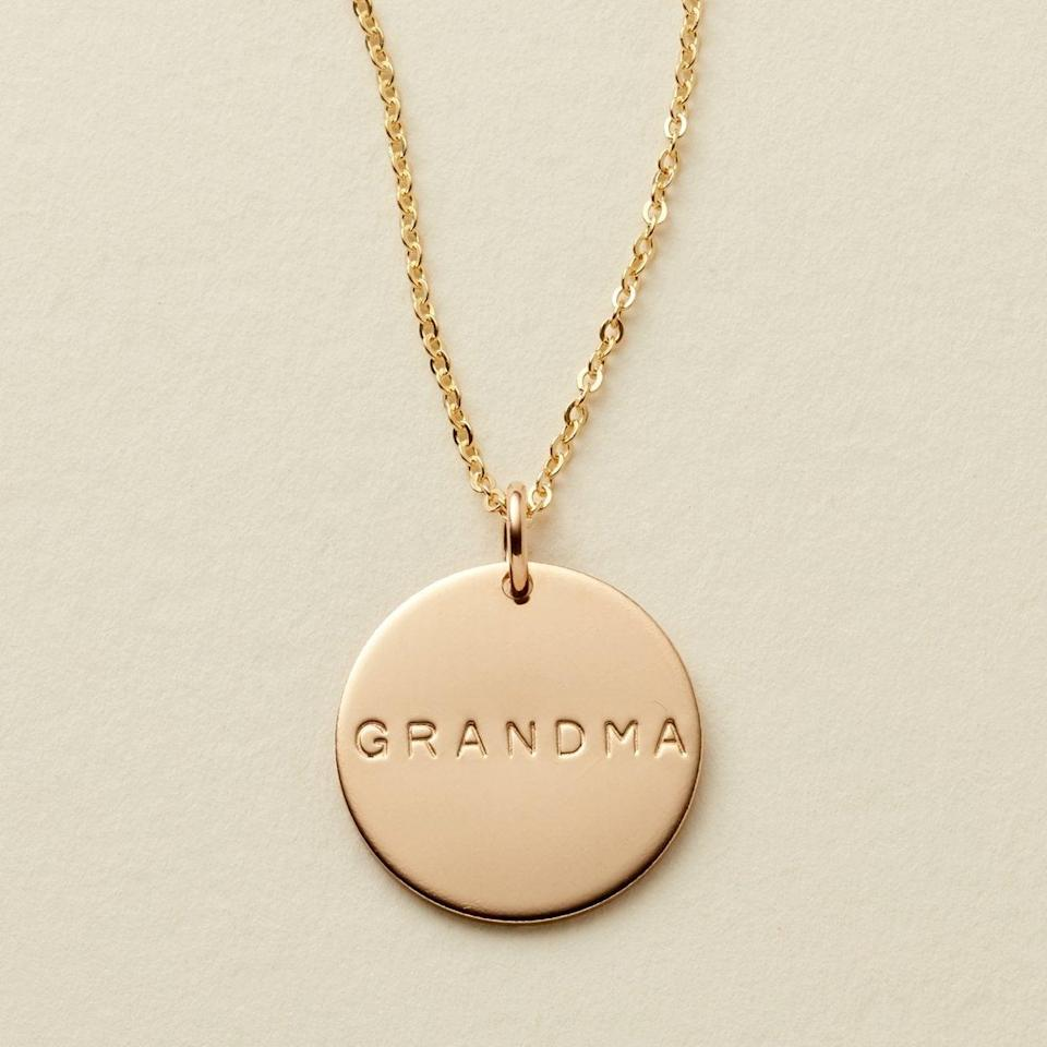 """<br> <br> <strong>Made By Mary</strong> Grandma Disc Necklace - 5/8"""", $, available at <a href=""""https://go.skimresources.com/?id=30283X879131&url=https%3A%2F%2Fwww.madebymary.com%2Fproducts%2Fmama-disc-necklace-1%3Fvariant%3D41041886022"""" rel=""""nofollow noopener"""" target=""""_blank"""" data-ylk=""""slk:Made By Mary"""" class=""""link rapid-noclick-resp"""">Made By Mary</a>"""