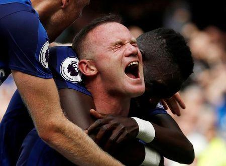 Football Soccer - Premier League - Everton vs Stoke City - Liverpool, Britain - August 12, 2017   Everton's Wayne Rooney celebrates scoring their first goal with team mates   Action Images via Reuters/Lee Smith