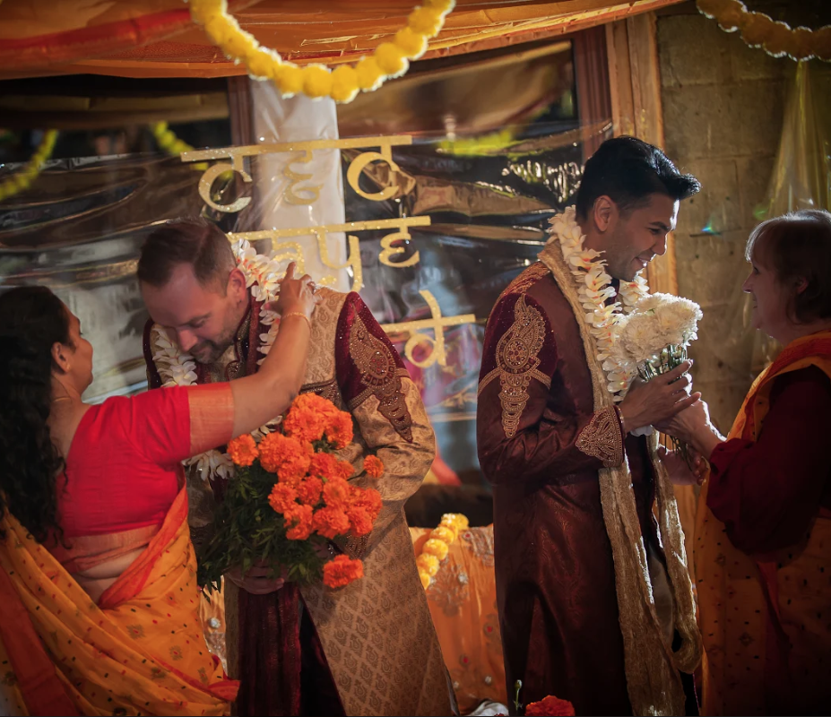 """<p>In October 2019, Chad and Clement had a three-day wedding, combining their cultures. """"We planned it by ourselves with help from Clement's sister, Mary. The weekend consisted of a traditional Bengali ceremony (a Gaye Holud), a more Western wedding on the second day, followed by a drag brunch on day three for those left standing. It was an unreal celebration of love and joy."""" They added, """"We reflect and appreciate what this means, and the fight that our predecessors endured to make a weekend like this possible. Both of us come from strictly conservative backgrounds. We felt less-than for who we loved, and feared the repercussions should our secret become public. The fact that we were able to share our love with our families and community, brings joy and pride to our love for each other. Everyone deserves happiness, free of fear. Finding ours and starting a life together as an example to a younger generation, is a path we happily walk.""""</p>"""