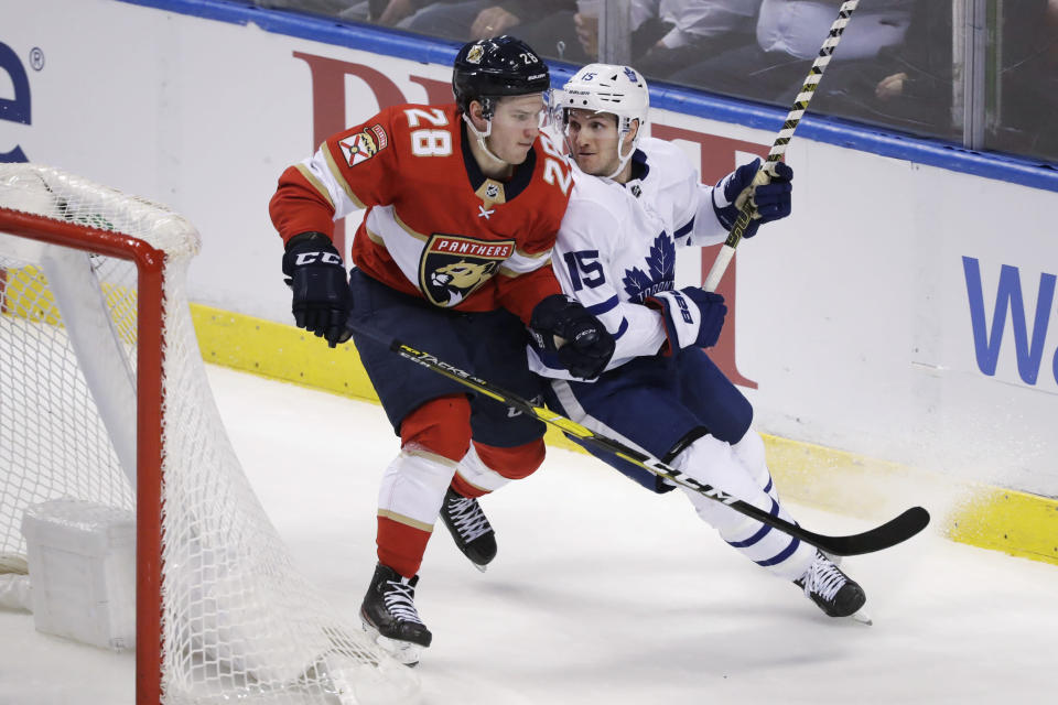 Florida Panthers center Aleksi Saarela (28) and Toronto Maple Leafs center Alexander Kerfoot (15) compete for the puck during the second period of an NHL hockey game Thursday, Feb. 27, 2020, in Sunrise, Fla. (AP Photo/Wilfredo Lee)