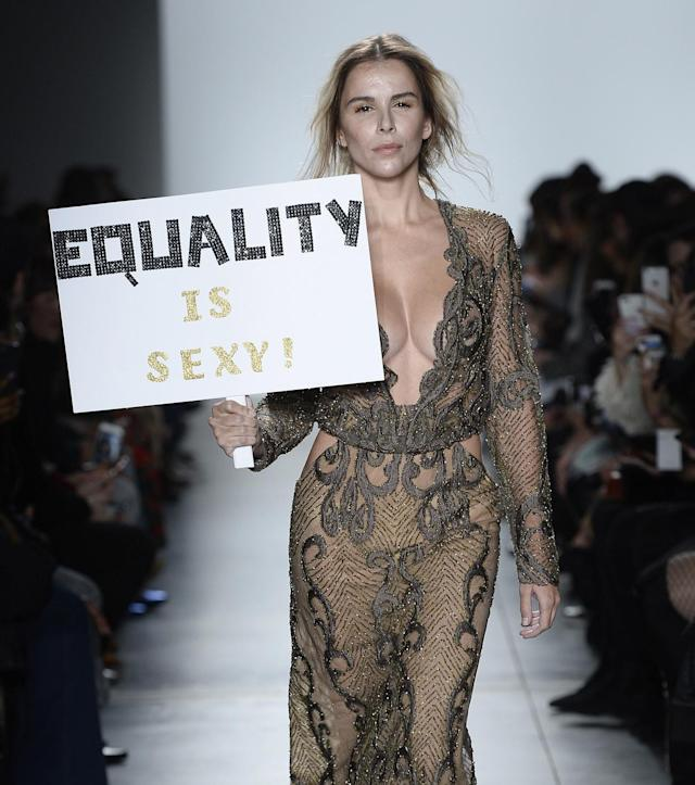 "<p>A model walks the Stella Nolasco runway show carrying a sign that reads ""Equality is sexy!"" during New York Fashion Week. (Photo: Getty Images) </p>"