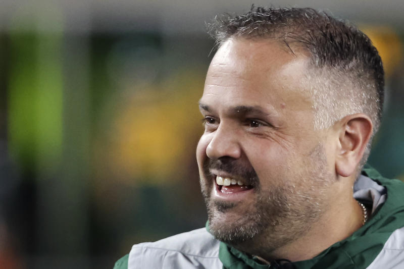 FILE - In this Nov. 16, 2019, file photo, Baylor head coach Matt Rhule stands on the field prior to an NCAA college football game against Oklahoma in Waco, Texas. A person familiar with the situation says the Carolina Panthers are completing a contract to hire Baylor's Matt Rhule as their coach. The person spoke to The Associated Press on Tuesday, Jan. 7, 2020, on condition of anonymity because the deal is not done. The Panthers have not spoken publicly about the coaching search.  (AP Photo/Ray Carlin, File)