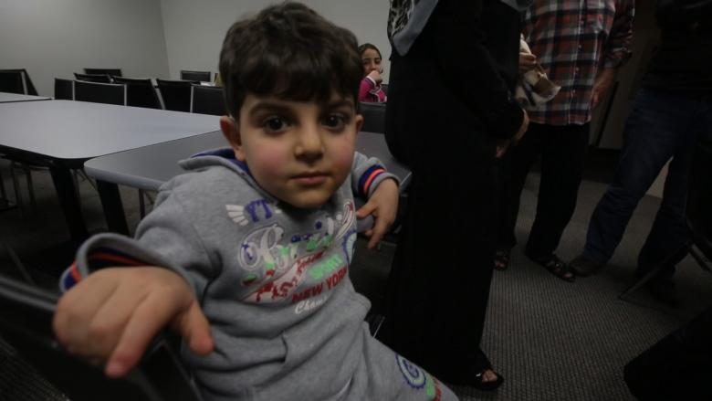 Syrian refugees say they're 'grateful' in spite of long wait in Toronto hotels