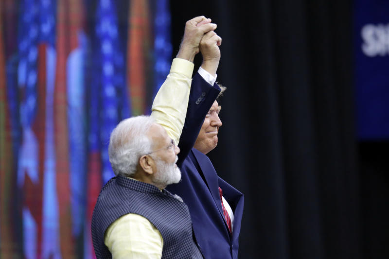 "India Prime Minister Narendra Modi and President Donald Trump on stage during introductions at the ""Howdi Modi"" event Sunday, Sept. 22, 2019, at NRG Stadium in Houston. (AP Photo/Michael Wyke)"
