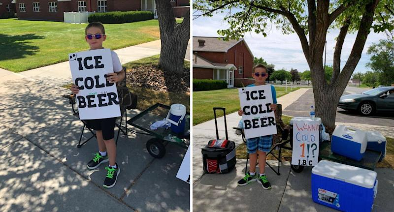 """Boy pictured holding sign advertising """"ice cold beer"""" with """"root"""" discretely written above beer."""
