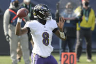 Baltimore Ravens quarterback Lamar Jackson (8) passes against the Tennessee Titans in the first half of an NFL wild-card playoff football game Sunday, Jan. 10, 2021, in Nashville, Tenn. (AP Photo/Mark Zaleski)