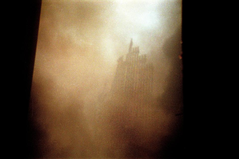 The Twin Towers rubble seen through the dust.