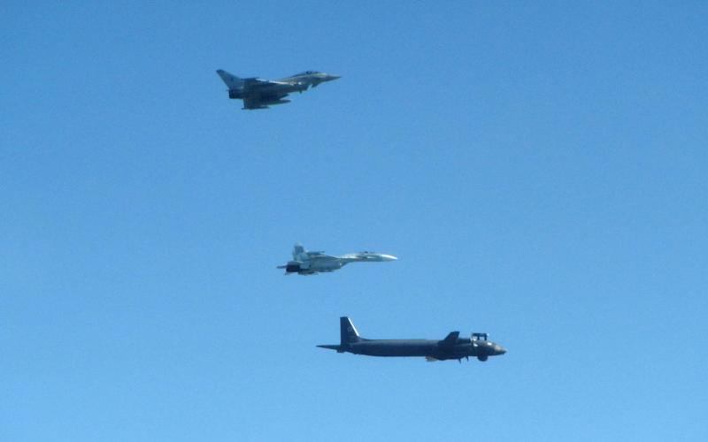 RAF Typhoon intercepting at Russian IL-38 'MAY' Maritime Patrol Aircraft and one of the SU-27 Flanker Bs. - RAF