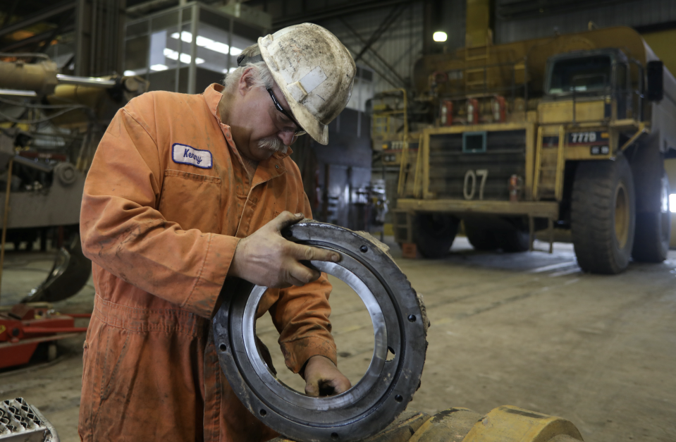 A mechanics works on mining equipment at the Black Butte coal mine outside Rock Springs, Wyoming, U.S. April 4, 2017. (Photo: REUTERS/Jim Urquhart)