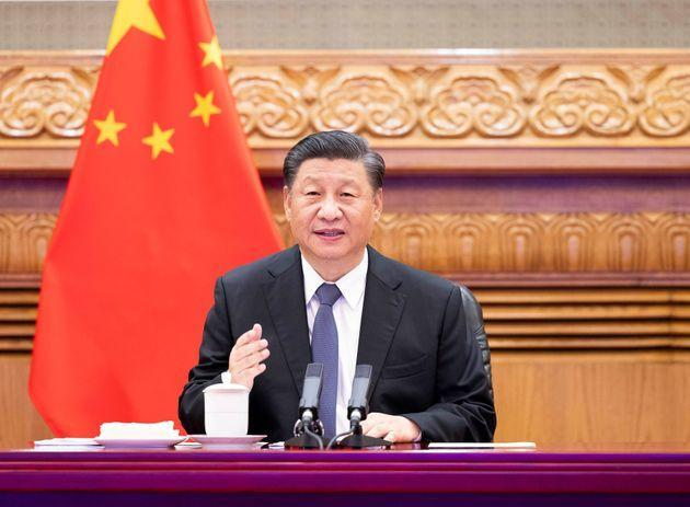 Chinese President Xi Jinping holds a virtual summit with French President Emmanuel Macron and German Chancellor Angela Merkel in Beijing, capital of China, July 5, 2021. (Photo by Huang Jingwen/Xinhua via Getty Images) (Photo: Xinhua News Agency via Getty Images)