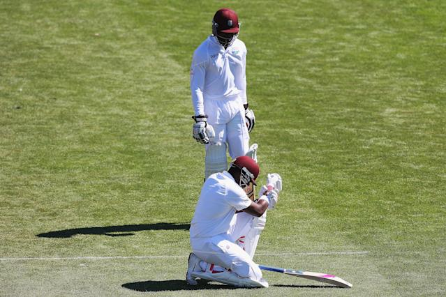 DUNEDIN, NEW ZEALAND - DECEMBER 05: Darren Bravo of the West Indies fallsa down after injuring his wrist during day three of the first test match between New Zealand and the West Indies at University Oval on December 5, 2013 in Dunedin, New Zealand. (Photo by Hannah Johnston/Getty Images)