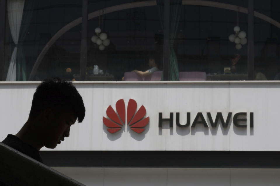 File Photo: A Chinese man is silhouetted near the Huawei logo in Beijing on Thursday, May 16, 2019. In a fateful swipe at telecommunications giant Huawei, the Trump administration issued an executive order Wednesday apparently aimed at banning its equipment from US networks and said it was subjecting the Chinese company to strict export controls. (AP Photo/Ng Han Guan)