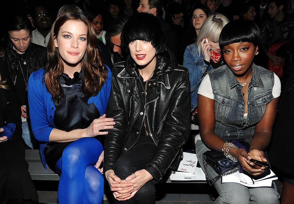 "Liv Tyler, who looked gorgeous in electric blue, cozied up to model Agyness Deyn and singer Estelle at the G-Star Raw Presents NY Raw show. Jamie McCarthy/<a href=""http://www.gettyimages.com/"" target=""new"">GettyImages.com</a> - February 16, 2010"