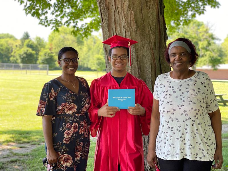 Markel Washington holds up his high school diploma as his mother LaShunda Washington (L) smiles proudly. (Photo: LaShunda Washington)