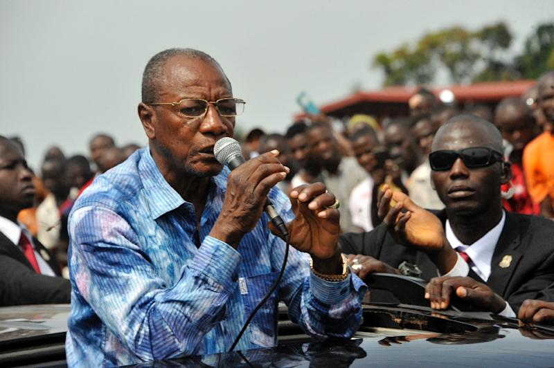 Guinea's President Alpha Conde speaks at a rally in Conakry on October 9, 2015 (AFP Photo/Cellou Binani)