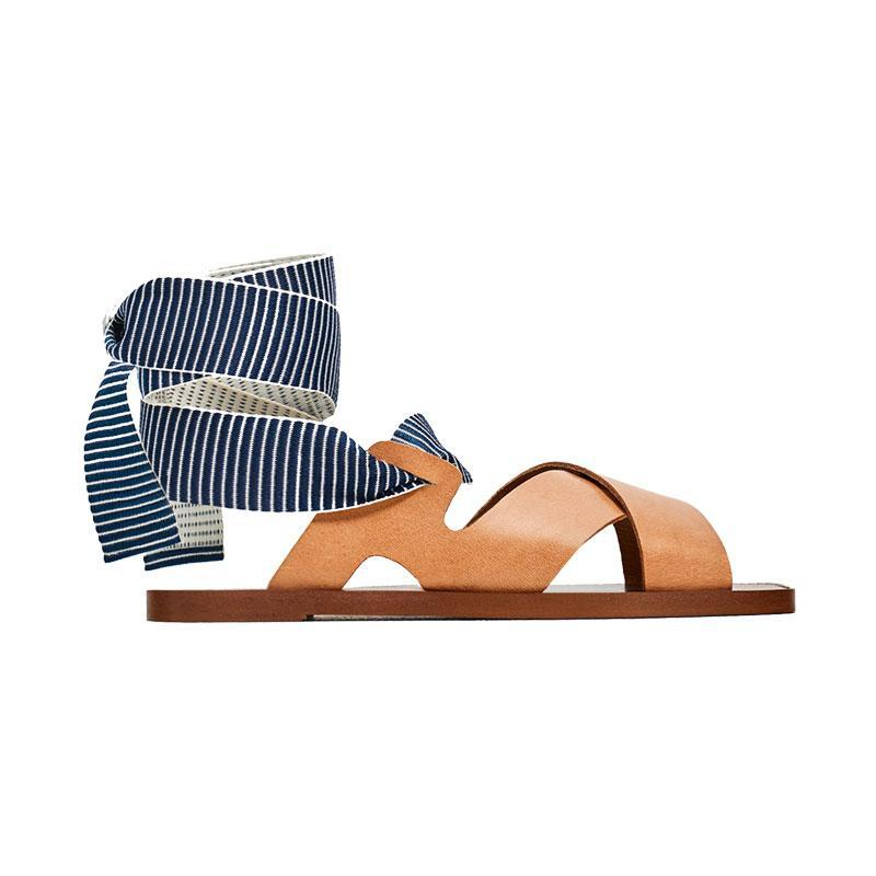 """<p><a href=""""https://www.zara.com/us/en/sale/woman/shoes/view-all/leather-slides-with-interchangeable-ribbons-c734178p4329503.html"""" rel=""""nofollow noopener"""" target=""""_blank"""" data-ylk=""""slk:Leather Slides With Interchangeable Ribbons,"""" class=""""link rapid-noclick-resp"""">Leather Slides With Interchangeable Ribbons,</a> <span><span>$60</span> $40</span></p>"""