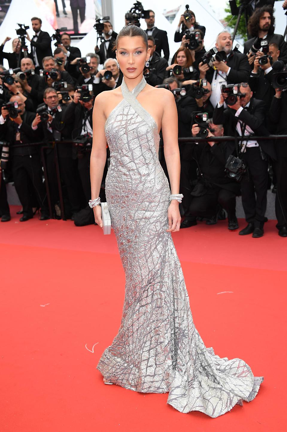 <p>The model looked gorgeous in a silver Elie Saab Couture gown which he wore with silver accessories. [Photo: Getty] </p>