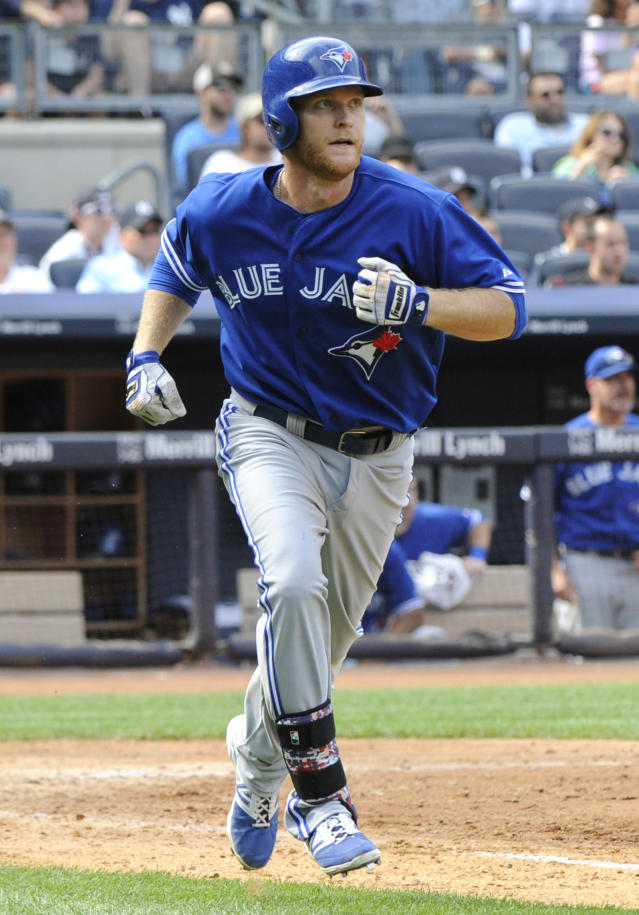 Toronto Blue Jays' Dan Johnson rounds the bases after hitting a three-run home run during the ninth inning of a baseball game against the New York Yankees, Saturday, July 26, 2014, at Yankee Stadium in New York. The Blue Jays won 6-4. (AP Photo/Bill Kostroun)
