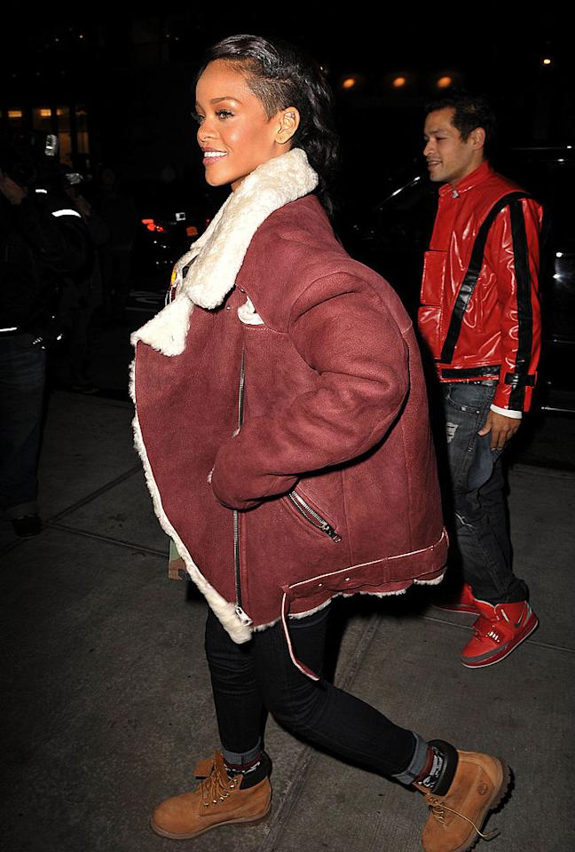 <p>Singer Rihanna paired her $2,300 dark burgundy Acne Velocite coat with Timberland boots and jeans. (Photo: Getty Images) </p>