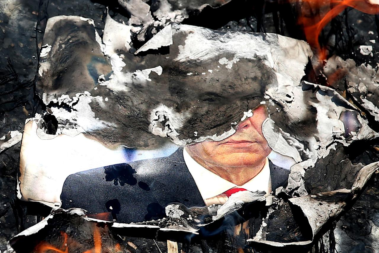 <p>A portrait of the Israeli Prime Minister Benyamin Netanyahu is set on fire during an annual pro-Palestinian rally marking Al-Quds (Jerusalem) Day at the Enqelab-e-Eslami (Islamic Revolution) St. in Tehran, Iran, July 10, 2015. (Photo: Ebrahim Noroozi/AP) </p>
