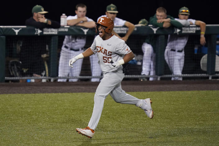 Texas' Camryn Williams celebrates a two-run homer against South Florida as he rounds the bases during the seventh inning of an NCAA Super Regional college baseball game, Sunday, June 13, 2021, in Austin, Texas. (AP Photo/Eric Gay)
