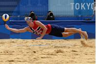 <p>Norway's Anders Berntsen Mol reaches for the ball in the men's beach volleyball quarter-final match against Russia.</p>