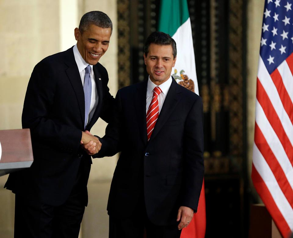 President Barack Obama, left, and Mexican President Enrique Pena Nieto shake hands following a news conference at the Palacio Nacional in Mexico City, Thursday, May 2, 2013.