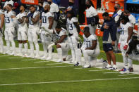 FILE - In this Sept. 27, 2020, file photo, members of the Tennessee Titans take part in the national anthem before an NFL football game against the Minnesota Vikings, in Minneapolis. Tennessee will not be returning to the team's facility Wednesday, Oct. 7, 2020, after two more players tested positive in the NFL's first COVID-19 outbreak, a person familiar with the situation told The Associated Press. The Titans had no positive tests Monday or Tuesday for the first time after six consecutive days of positive results. A third straight day was necessary for the team to be allowed back in its headquarters.(AP Photo/Jim Mone)
