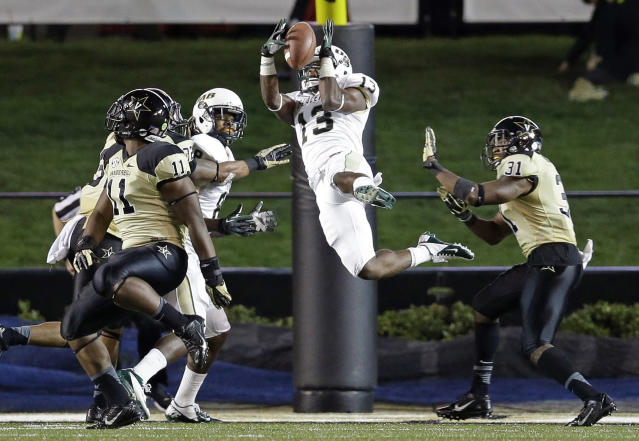 UAB cornerback Darius Powell (13) catches a 29-yard touchdown pass as he is defended by Vanderbilt safety Javon Marshall (31) and linebacker Harding Harper (11) in the fourth quarter of an NCAA college football game on Saturday, Sept. 28, 2013, in Nashville, Tenn. (AP Photo/Mark Humphrey)