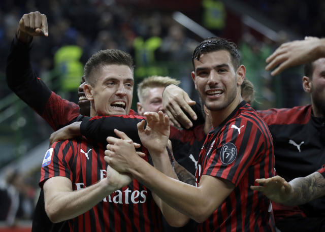 AC Milan's Krzysztof Piatek, left, celebrates his goal with teammates during a Serie A soccer match between AC Milan and Lecce, at the San Siro stadium in Milan, Italy, Sunday, Oct.20, 2019. (AP Photo/Luca Bruno)