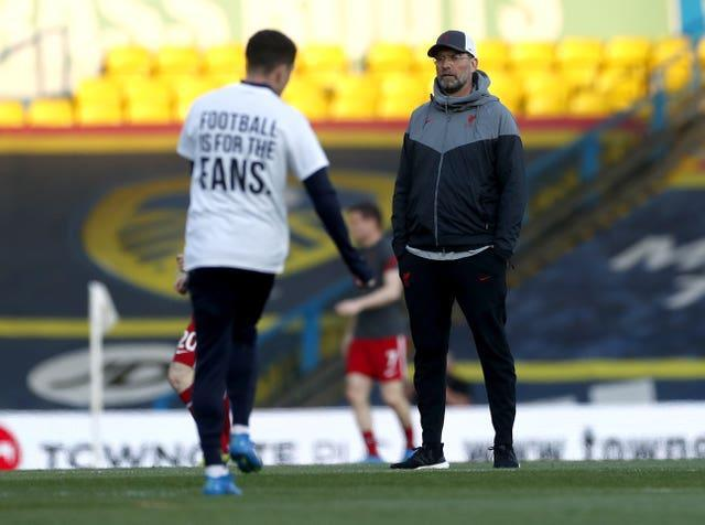Liverpool manager Jurgen Klopp looks on as Leeds winger Pablo Hernandez warms up wearing a t-shirt opposing the European Super League. The announcement that Arsenal, Chelsea, Liverpool, Manchester City Manchester United and Tottenham would break away from the Premier League to join the new competition was greeted by shock, anger and widespread opposition. The so-called top-six Premier League clubs swiftly withdrew from the ill-fated venture but were left embarrassed and attempting to appease unhappy supporters