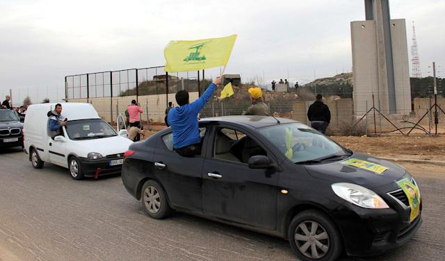 <p>Hezbollah supporters rally in the area of Fatima's Gate in Kfar Kila on the Lebanese border with Israel on Feb. 10, 2018 to celebrate the crashing of an Israeli air jet and to denounce the Israeli attacks on Syria. (Photo: Ali Dia/AFP/Getty Images) </p>