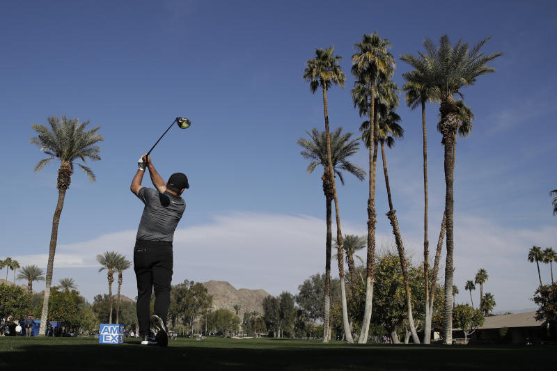 Francesco Molinari watches his shot from the fifth tee during the first round of The American Express golf tournament at La Quinta Country Club on Thursday, Jan. 16, 2020, in La Quinta, Calif. (AP Photo/Marcio Jose Sanchez)