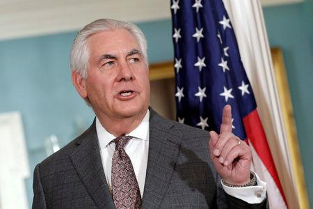 FILE PHOTO: U.S. Secretary of State Rex Tillerson talks to members of the media before his meeting with Qatari Foreign Minister Sheikh Mohammed bin Abdulrahman Al Thani at the State Department in Washington, DC, U.S. on November 20, 2017. REUTERS/Yuri Gripas/File Photo