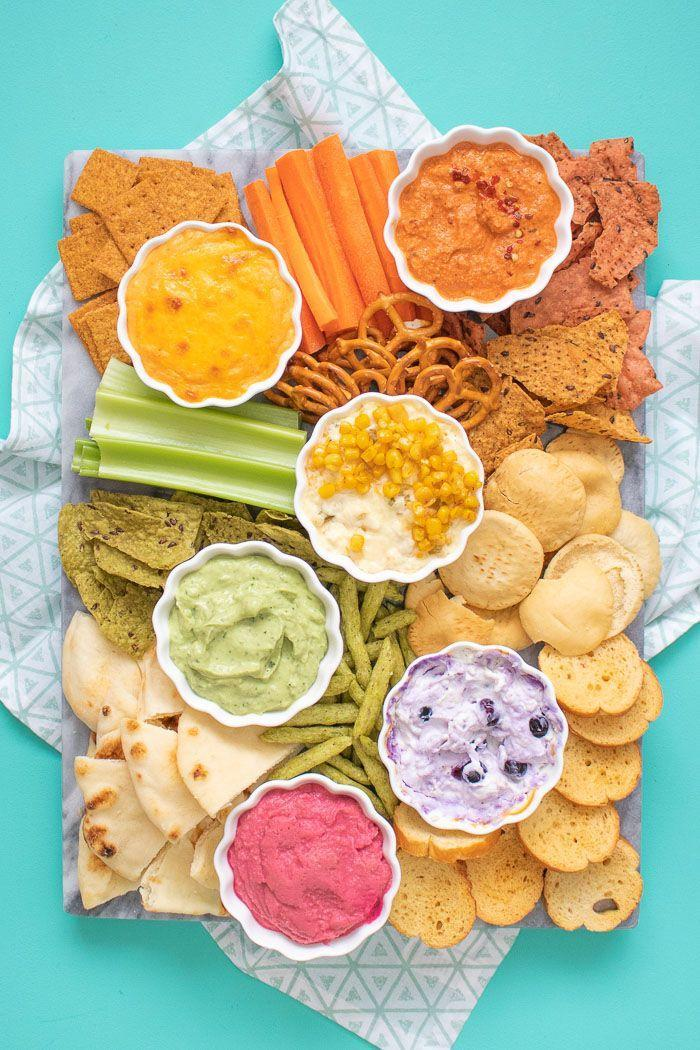 "<p>These colorful ideas prove that comfort-food snacking isn't just for colder months.</p><p><em><a href=""https://www.clubcrafted.com/rainbow-dip-ideas-summer/"" rel=""nofollow noopener"" target=""_blank"" data-ylk=""slk:Get the recipe from Club Crafted »"" class=""link rapid-noclick-resp"">Get the recipe from Club Crafted »</a></em></p>"