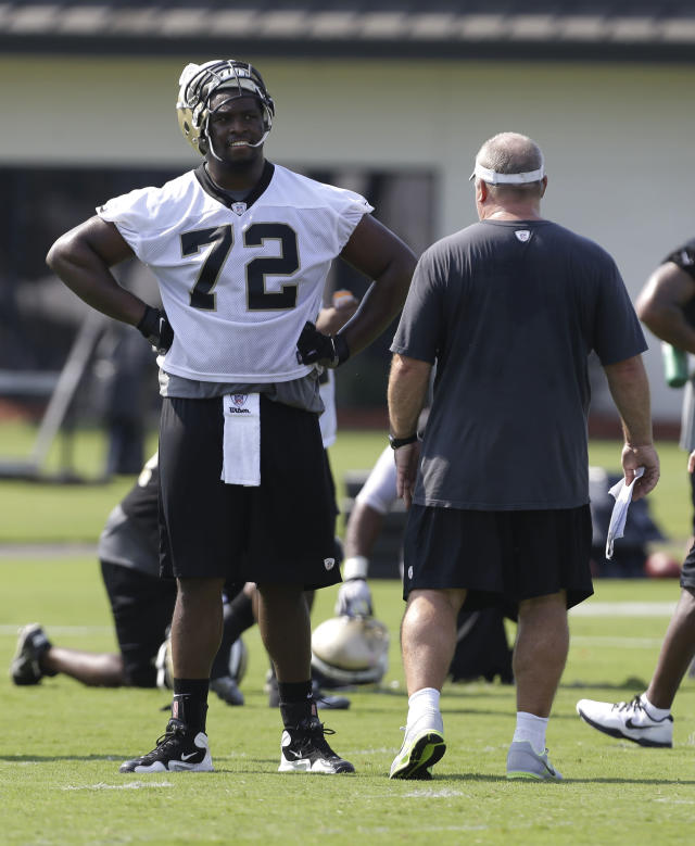 FILE - In this July 26, 2013 file photo, New Orleans Saints offensive tackle Terron Armstead (72) talks with offensive line coach Brett Ingalls during NFL football training camp in Metairie, La. Sean Payton says the Saints have signed veteran kicker Shayne Graham and will start rookie Terron Armstead at left tackle in Sunday's, Dec. 22, 2013, pivotal NFC South clash with Carolina. (AP Photo/Gerald Herbert, File)