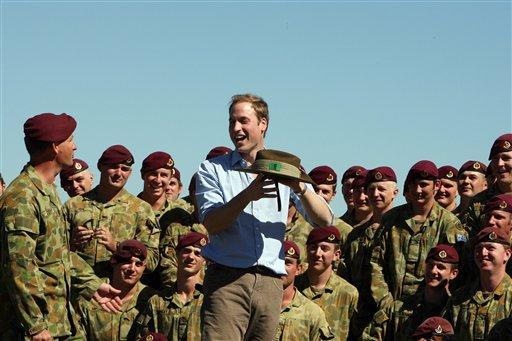 Britains' Prince William interacts with members of the 3rd Battalion, Royal Australian Regiment during his unofficial visit to Sydney, Wednesday, Jan. 20, 2010. ( AP Photo/Rick Stevens, Pool)