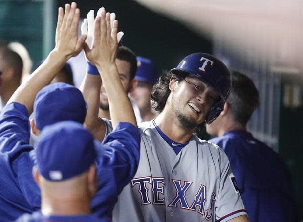 Yu Darvish celebrates his unexpected but historic first MLB home run. (AP)