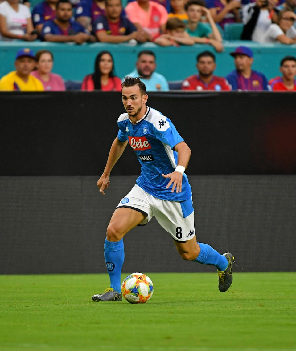 Aug 7, 2019; Miami, FL, USA; Napoli midfielder Fabian Ruiz (8) dribbles the ball against Barcelona during the first half of the United States La Liga-Serie A Cup Tour soccer match at Hard Rock Stadium. Mandatory Credit: Jasen Vinlove-USA TODAY Sports