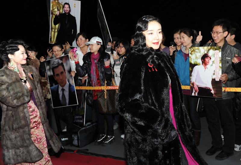 The main driver of Chinese cinema's phenomenal growth is asteady emergence of a modern consumerist lifestyle among China's burgeoning middle class, expected to account for 75% of households within a decade (AFP Photo/Mark Ralston)