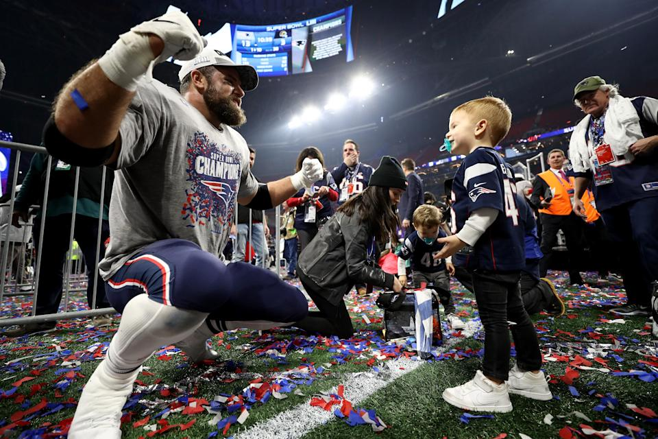 <p>James Develin #46 of the New England Patriots celebrates with his son after the Super Bowl LIII against the Los Angeles Rams at Mercedes-Benz Stadium on February 3, 2019 in Atlanta, Georgia. The New England Patriots defeat the Los Angeles Rams 13-3. (Photo by Jamie Squire/Getty Images) </p>