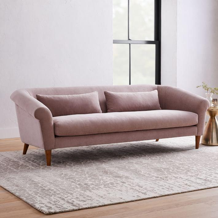 <p>This <span>West Elm Parlour Sofa</span> ($1,400 - $1,900) will be the focal point of the room - keep the rest of the area neutral.</p>