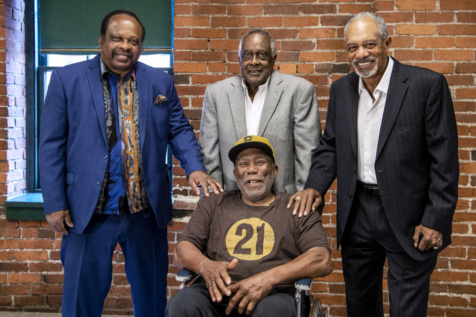Al Oliver, Gene Clines, Manny Sanguillen, seated, and Dave Cash pose for a portrait during an event hosted by the Pittsburgh Pirates to celebrate the 50th anniversary of the first all-minority lineup to take the field in Major League Baseball history, at the Heinz History Center, Wednesday, Sept. 1, 2021, in Pittsburgh. (Alexandra Wimley/Pittsburgh Post-Gazette via AP)